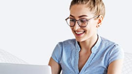 Young woman with glasses using laptop