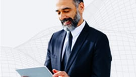 Man in business suit using a tablet